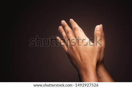 Praying hands with faith in religion and belief in God on dark background. Power of hope or love and devotion. Namaste or Namaskar hands gesture. Prayer position. #1492927526