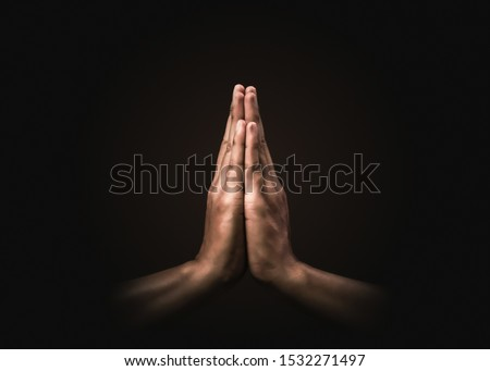 Praying hands with faith in religion and belief in God on dark background. Power of hope or love and devotion. Namaste or Namaskar hands gesture. Prayer position. Foto stock ©