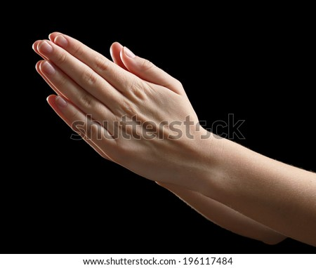 Praying human hands on black background #196117484