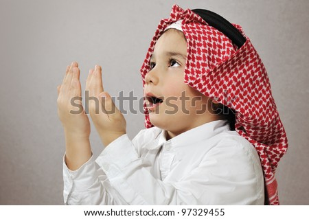 Praying Islamic Kid - stock photo