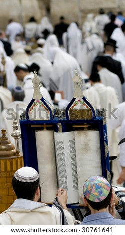 Praying Jewish with Torah scroll at Passover