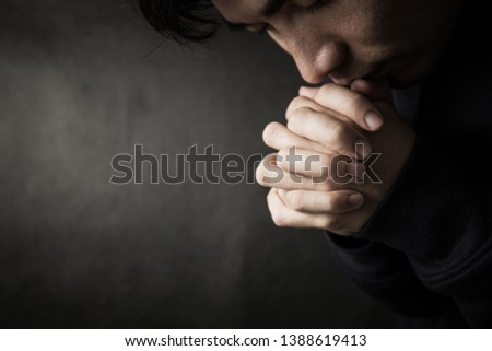 Praying man hoping for better. Asking God for good luck, success, forgiveness. Power of religion, belief, worship. Holding hands in prayer, eyes closed. Stock foto ©