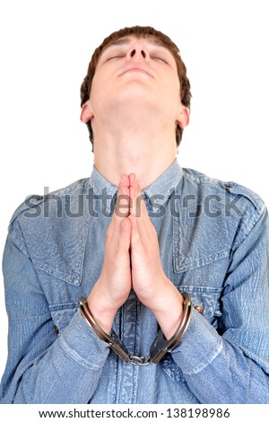 Praying Man in Handcuffs Isolated on the White Background