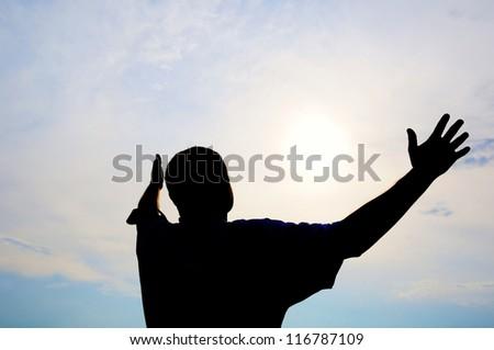 Praying man. Silhouette. - stock photo