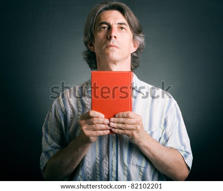 Praying man with Bible in hand.