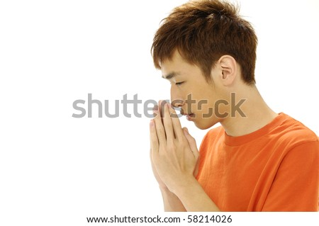 Praying Man with copy space - stock photo