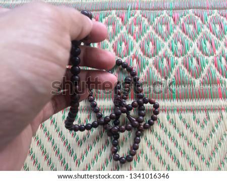 Praying wearing rosary beads (tasbih) on the met. Top view close up rosary beads (tasbih). #1341016346