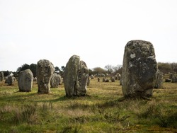 Pre celtic Carnac standing granite stones menhir megalith monolith rock alignment row Brittany France Europe