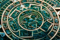 Pre Columbian culture and indigenous civilizations concept them with close up on a aztec sun calendar made of semi precious jade stone