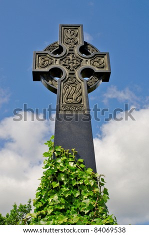 Pre 1900 irish celtic cross with traditional celtic carving from a grave in the famous Milltown Cemetery Belfast, the largest Catholic burial ground in Belfast synonymous with Irish Republicanism.