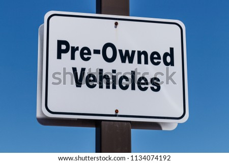 Pre Owned Vehicles sign at a Used Car Dealership