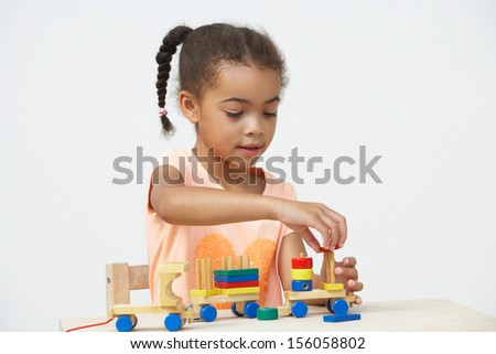 Pre-School Pupil Playing With Wooden Toy Train Stock photo ©
