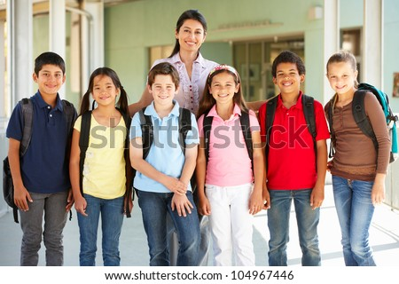 Pre teen schoolchildren with teacher
