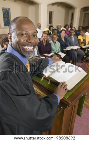 Preacher and Congregation - stock photo