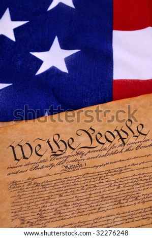 Preamble to the US Constitution with the stars and stripes in the background #32276248