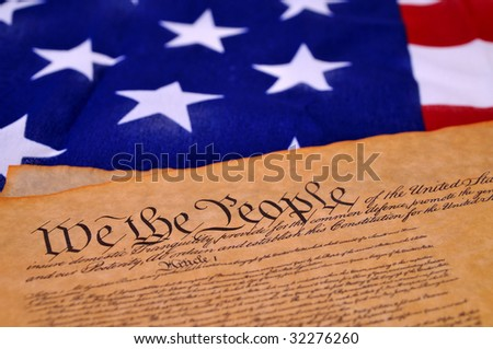 Preamble to the US Constitution with the stars and stripes in the background #32276260