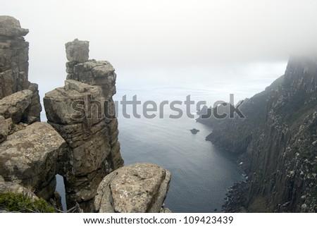 Precarious stacks of dolerite form the rugged cliffs of Cape Pillar, Tasmania #109423439