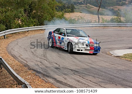 PREDAPPIO, ITALY - JULY 21: unidentified driver on a  a drift racing car BMW in hairpin bend at rally Predappio legend 2012, historical italian uphill race, on July 21, 2012 in Predappio, FC, Italy