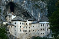 Predjama Castle Castello di Predjama o Castel Lueghi built within a cave near Postojna. Renaissance castle built within a cave mouth in south-central Slovenia. High quality photo