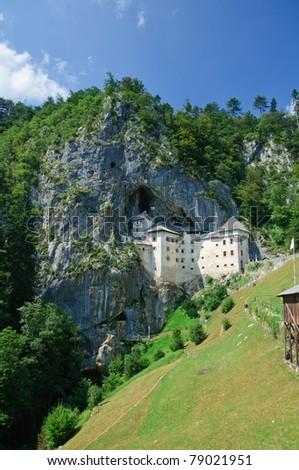 Predjama Castle in Postojna, Slovenia. Vertical view - stock photo