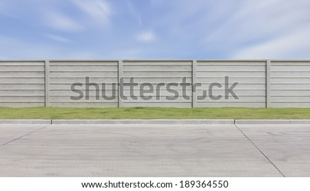 Prefabricated concrete fence and concrete floor with blue sky background. #189364550