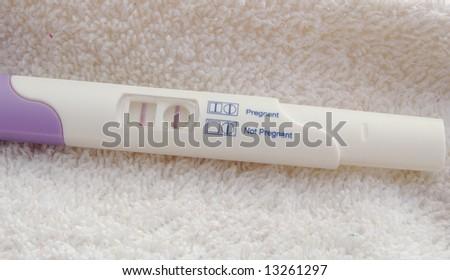 pregnancy test kit showing positive