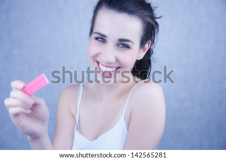 Pregnancy test positive or negative result. Smiling young woman.