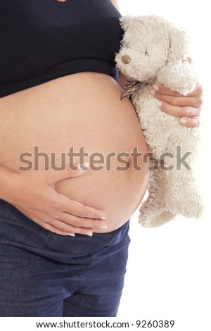 Pregnancy woman with teddy bear a over white background