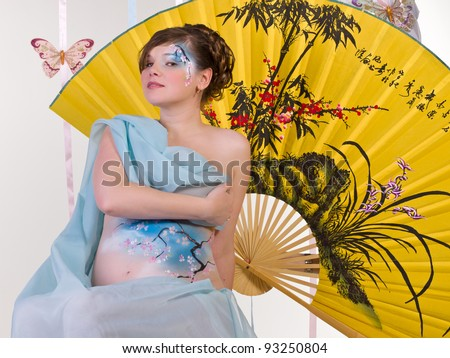 Pregnant body-art - Blue japan cherry tree