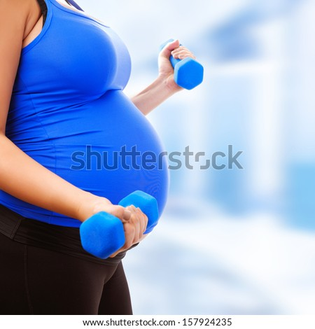 Pregnant Female Do Exercise In Sports Hall, Side View, Body Part, Lifting Dumbbells, Active And Sportive Pregnancy, Healthy Motherhood Concept