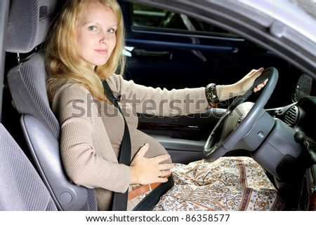 pregnant in the car - stock photo
