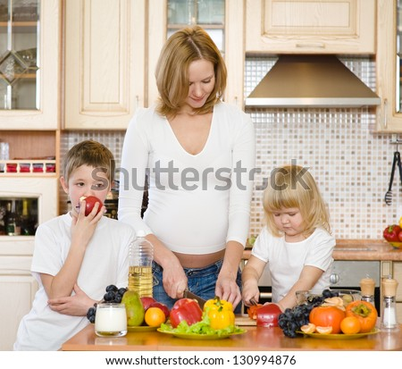 pregnant mother and kids in kitchen