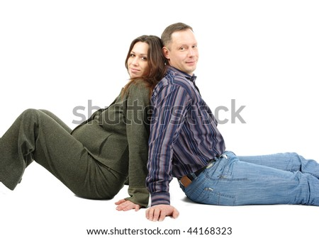 Pregnant wife and husband support each other sitting, isolated on white