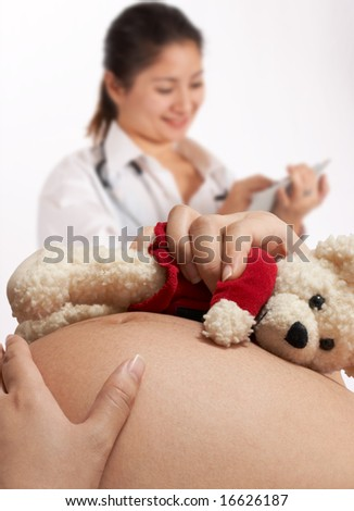 pregnant woman and a doctor in a hospital