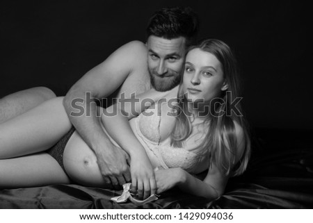 Pregnant woman and her man  studio black and white photography #1429094036
