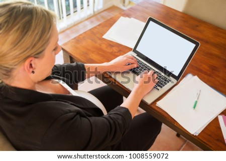 Pregnant woman at work  - Shutterstock ID 1008559072