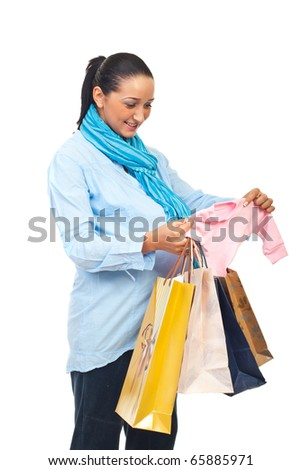 Pregnant woman bought baby clothes and holding shopping bags isolated on white background