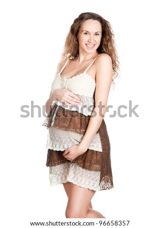 pregnant woman caressing her belly over white background