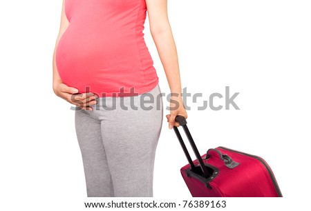 Pregnant woman carrying suitcase and ready for maternity hospital