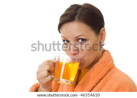 pregnant woman drinking tea in an orange smock with a white