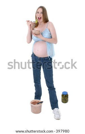 stock photo : Pregnant woman eating pickles and ice cream. Great expression.
