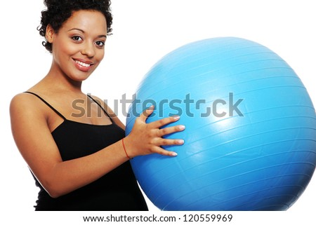 Pregnant woman exercises with big blue gymnastic ball