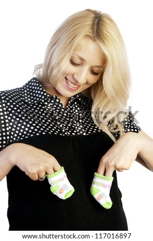 Pregnant woman holding baby's socks