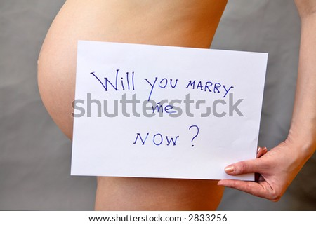 "Pregnant woman holding tablet with question: ""Will you marry me now ?"""