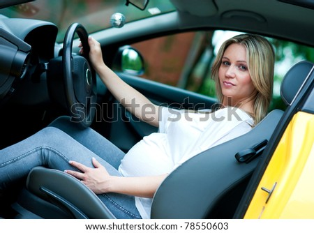 pregnant woman in driving seat of the car