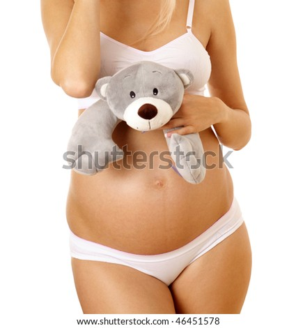 pregnant woman in lingerie on white background