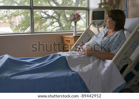 Pregnant woman in the hospital bed awaiting the birth of a child.