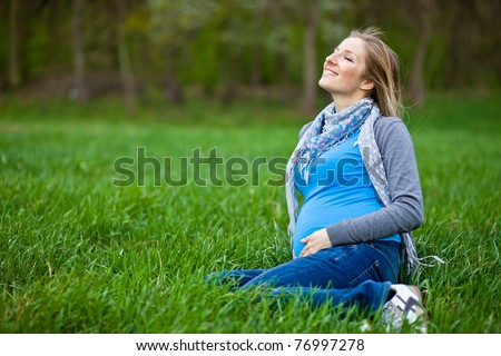 Pregnant woman outdoor spring time