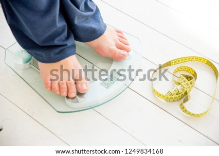 pregnant woman standing on scales to control weight gain