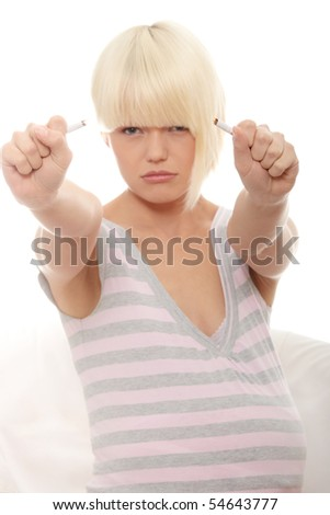 stock photo : Pregnant woman stops smoking - focus on hand
